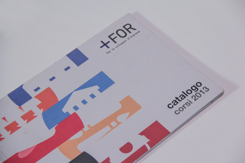 The catalogue's cover, a white rectangle with narrow bands on the left which represent the details of the training courses explained inside, while on the right we can fin the For Plus logo.