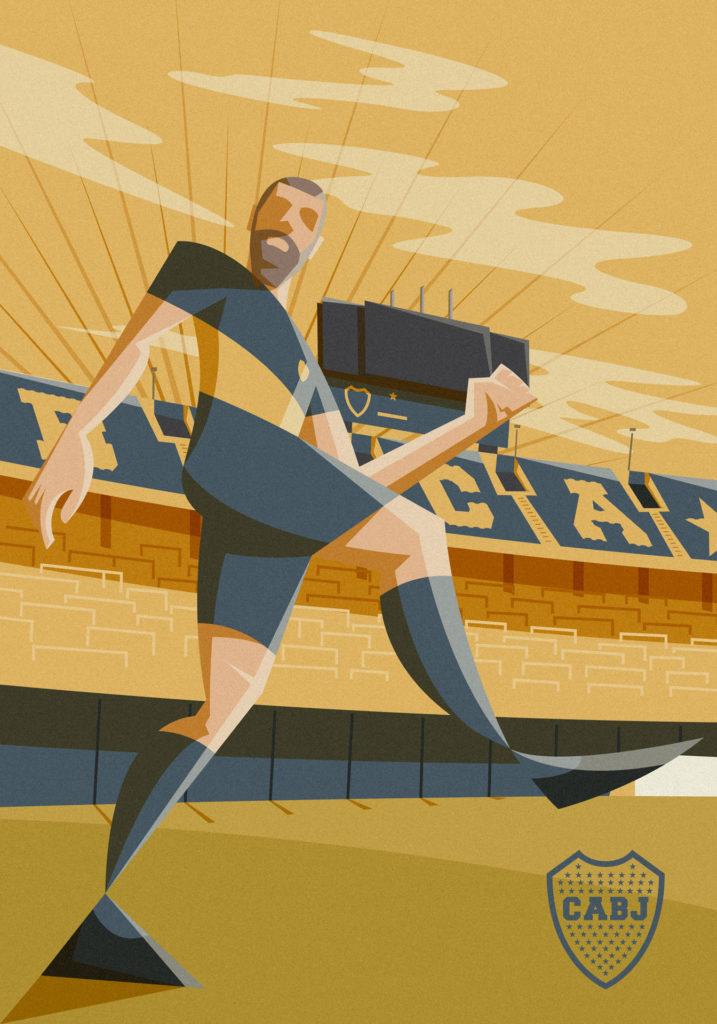 """Daniele De Rossi è del Boca Juniors. Una scelta fatta col cuore, nella composizione campeggia """"Tano"""" ripreso dal basso verso l'altro con alle spalle lo stadio giallo blu della formazione argentina, il tutto ripreso nelle calde luci della sera."""