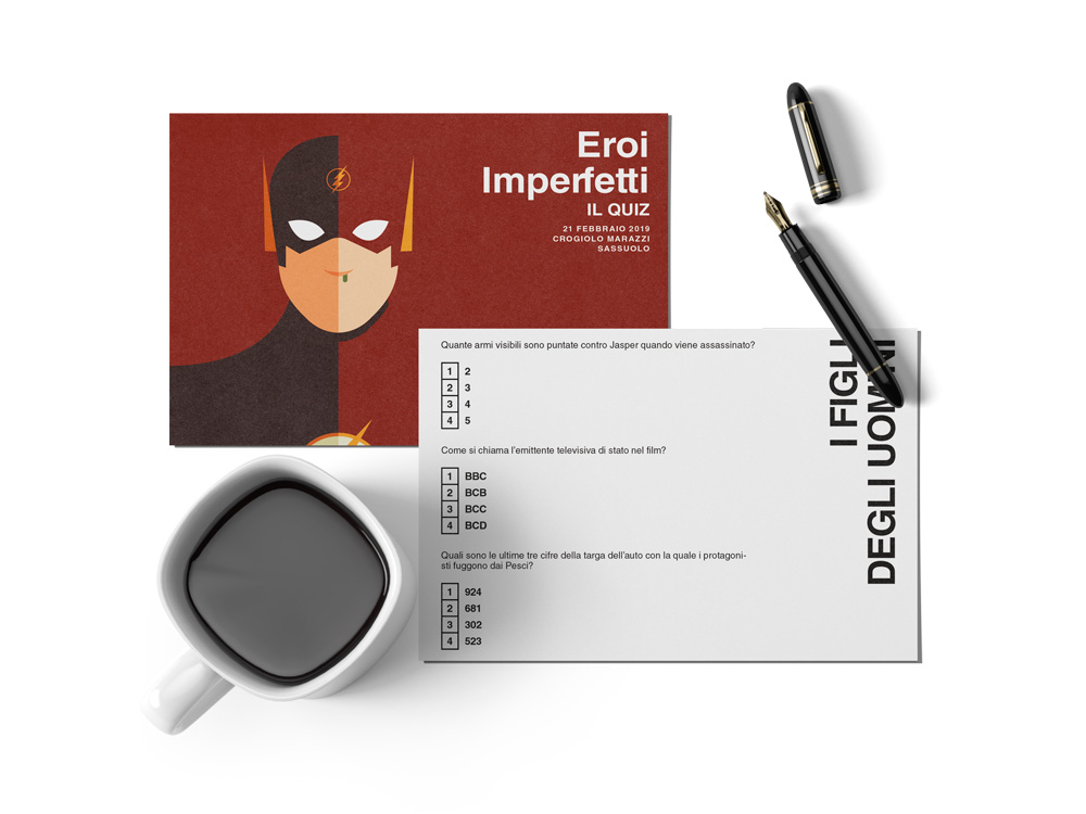 "Imperfect Heroes: The Flash card front and back. The Flash postcard front and back next to a cup of coffee and a pen. On the back of the card there is the quiz, in this case it's about the movie ""Children of men""."